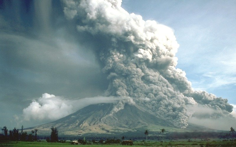 The Plinian eruption of Mt. Mayon, Philippines in 1984. Although most of the eruption column is ascending into the atmosphere, pyroclastic flows are traveling down the sides of the volcano in several places. Warnings were issued in time to evacuate 73,000 people.