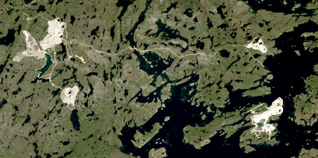 Figure 20.25 Diamond mines in the Lac de Gras region, Nunavut. The twin pits of the Diavik Mine are visible in the lower right on an island within Lac de Gras. The five pits of the Ekati mine are also visible, on the left and the upper right. The two main mine centres are 25 km apart. [http://earthobservatory.nasa.gov/IOTD/view.php?id=84085&src=eoa-iotd]