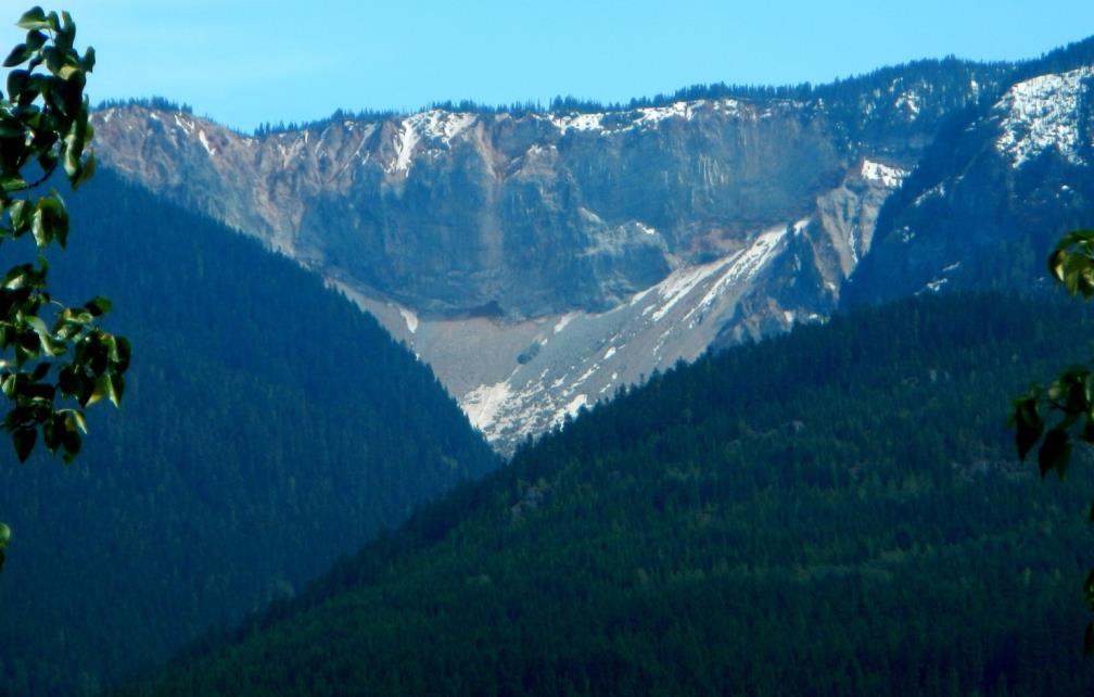 Figure 15.23 The Barrier, south of Whistler, B.C., was the site of a huge rock avalanche in 1855, which extended from the cliff visible here 4 km down the valley and across the current location of the Sea-to-Sky Highway and the Cheakamus River. [SE]