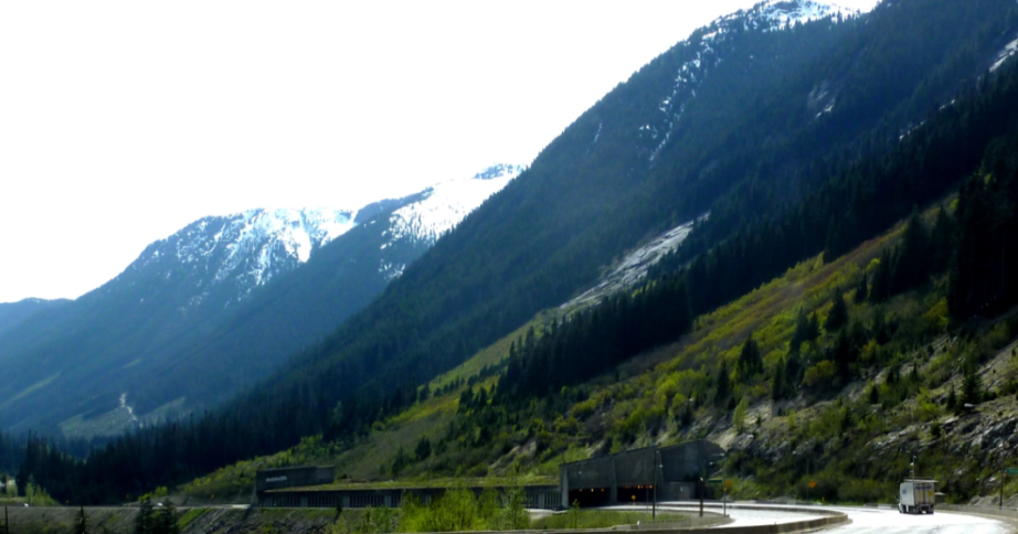 Figure 15.21 A snow avalanche shelter on the Coquihalla Highway. The expected path of the avalanche is the steep untreed slope above. [SE]